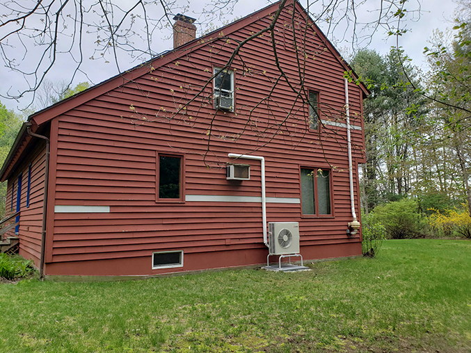 hyper heat pump on exterior of brentwood nh home's