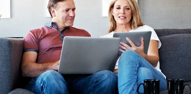 Seacoast NH Couple looking for HVAC financing on laptops